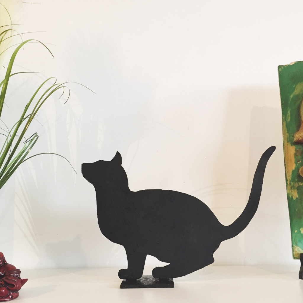 Cat leaping statuette